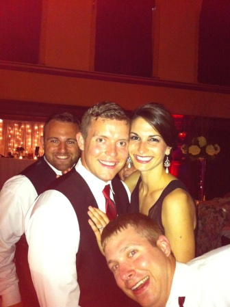 This was at the wedding. Mr. Speedy's friends were extremely happy to be a part of our photo.