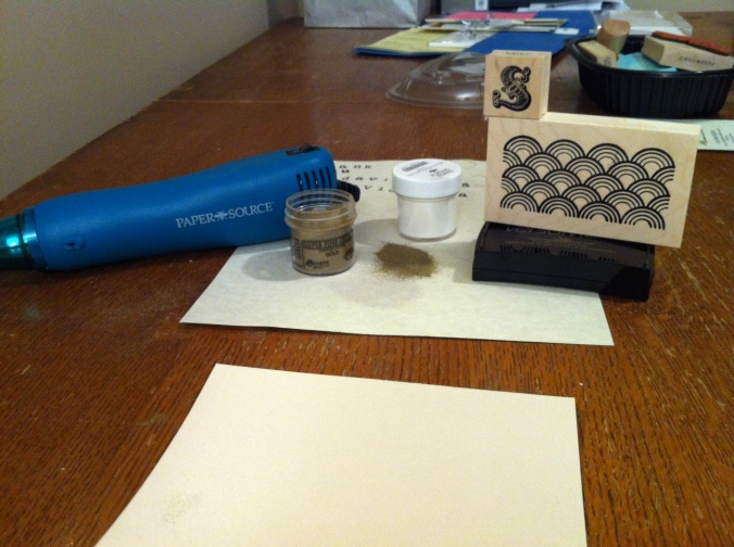 You need: paper, stamp, embossing powder, ink pad, and heat gun.