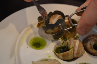 Eating snails is serious. You get special tools.