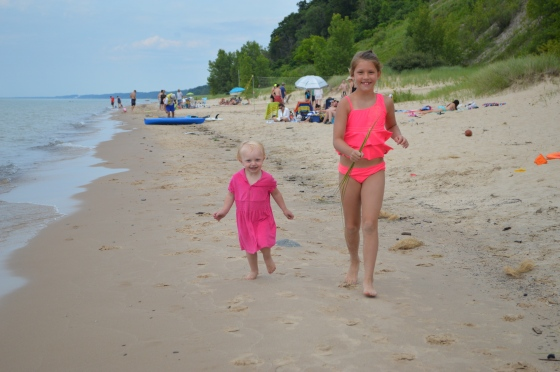 Nieces running in the sand.